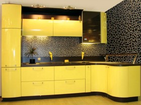 Yellow kitchen furniture against black walls