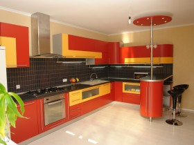 Bright kitchen with yellow and red furniture