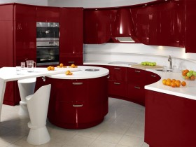 Red and white kitchen in the style of hi-tech