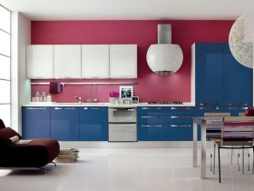 Bright kitchen with blue furniture and pink wall