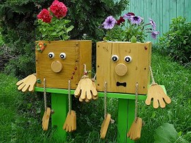 Wooden garden figures as pots for flowers