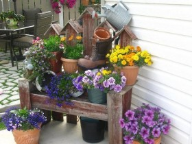 Landscaping garden benches with flowers in pots