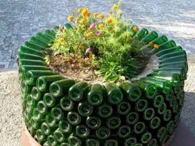 Flowerbed of glass bottles