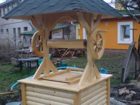 A wooden well with modern canopy