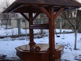 The well with wood and natural stone