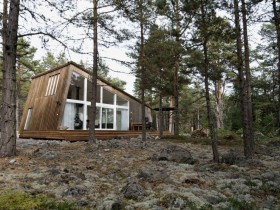 Design of wooden cottage in the woods