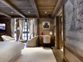 Bedroom with wooden walls, ceiling and floor