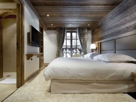 Bedroom interior with wooden finish with a large window