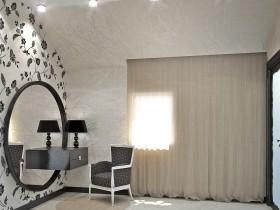 Арыгінальны дызайн трыльяжа ў светлай спальні