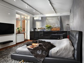 Black bed on the gray background of the bedrooms in the style of constructivism