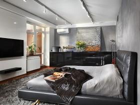 Черная кровать на фоне серой спальни в стиле конструктивизм
