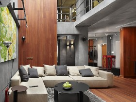 Large combined living room with white corner sofa in the style of constructivism