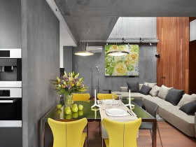 Dining room with yellow chairs in the cottage style of constructivism