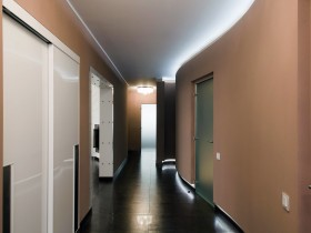 Modern hallway in the apartment with hidden lighting