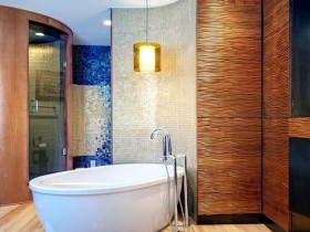 Designer bathroom with bath and shower