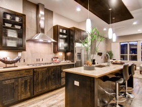 The modern kitchen is wood with light walls