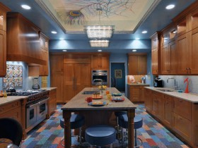 Kitchen under the tree with blue floors, the chairs and ceiling