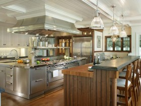 Bright kitchen in wooden finish with a large kitchen island
