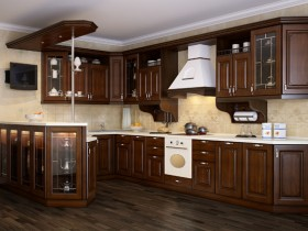 Kitchen dark wood with light walls and extractor fan