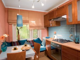 Bright small kitchen under the tree