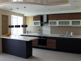 Modern kitchen with dark furniture