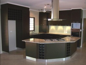 Large kitchen with dark furniture