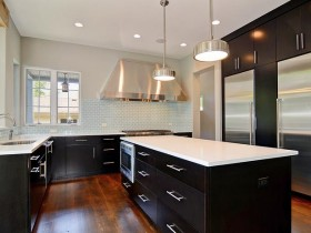 Black kitchen cabinetry with white countertops