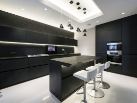 Combined kitchen with dining area in black and white