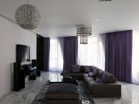 Spacious living room with black furniture and white walls