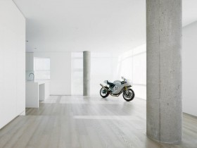 The bike is in the interior of the apartment