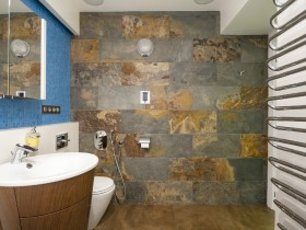 "Modern bathroom with wall ""under the stone"""