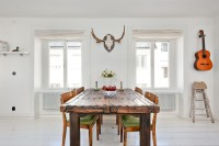 White room with wooden table in Scandinavian style