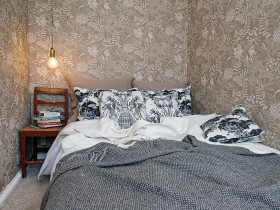 Bedroom, wallpapered in shades of gray