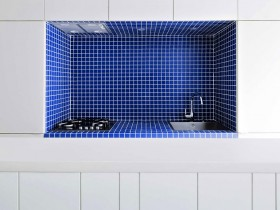 Kitchen in a minimalist style, table in white-blue tones