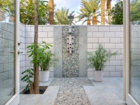 Stylish outdoor shower in the courtyard