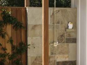 Outdoor shower under a pergola