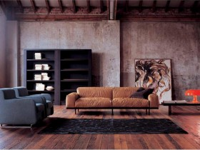 Living room interior with concrete wall and brown sofa, loft style