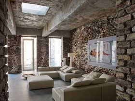 Living room with brick walls and concrete ceilings, loft style