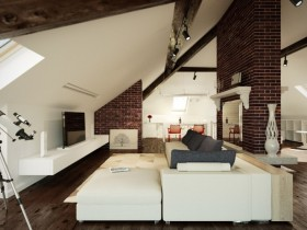 Living room with sloping ceiling in the loft
