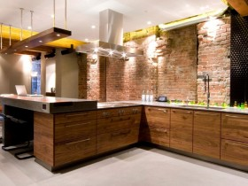 Kitchen with wooden furniture and brick walls, loft style