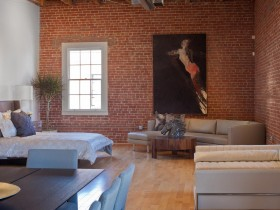 Living room with brick walls