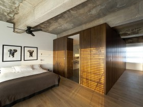 Bedroom with concrete ceiling loft-style