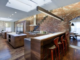 Beautiful kitchen with brick walls and white ceiling
