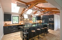 Bright kitchen with black furniture, loft-style