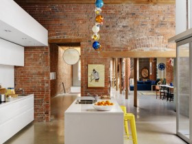 Kitchen with brick walls and white furniture