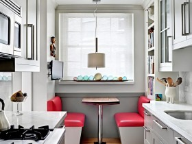 Small white kitchen with the bright chairs