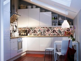 The interior of a small kitchen with sloping ceiling
