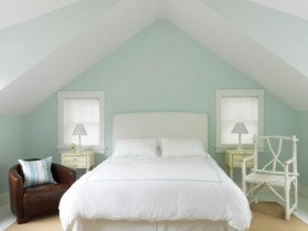 White bedroom with sloping ceiling