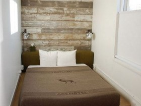 Small white bedroom with wooden wall
