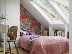 Small bedroom with large Windows and sloping ceiling